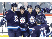 Winnipeg Jets' Adam Lowry (56), Scott Kosmachuk (72), TJ Galiardi (21), Julian Melchiori (71) and Will O'Neill (43) celebrate Galiardi's goal against the Edmonton Oilers during first period NHL pre-season action in Winnipeg on Wednesday, September 24, 2014. THE CANADIAN PRESS/John Woods