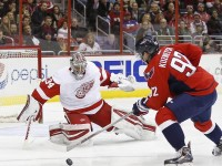 Jan 10, 2015; Washington, DC, USA; Washington Capitals center Evgeny Kuznetsov (92) prepares to shoot the puck on Detroit Red Wings goalie Petr Mrazek (34) in the third period at Verizon Center. The Capitals won 3-1. Mandatory Credit: Geoff Burke-USA TODAY Sports